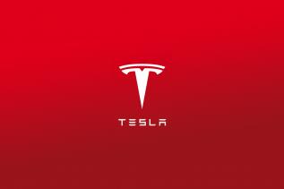 Obrazek przedstawia logo firmy Tesla, o której jest artykuł.